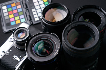 Close up photo of Collection of camera lens well organized over black background.