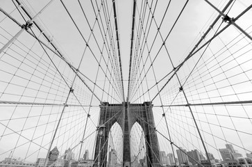 Perfect geometry of the Brooklyn Bridge cable web with overlook on Manhattan black and white monochrome retro photo