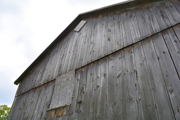 Barn. Unfiltered, with natural lighting. An old gray rustic barn.