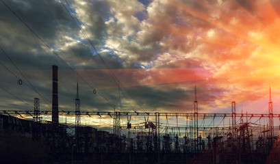 electricity distribution station at sunset .