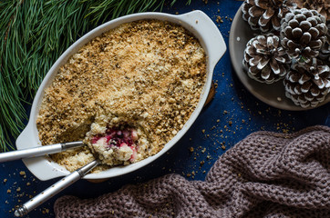 Crumble with berries and fruit for breakfast