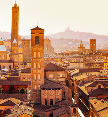 Bologna, cityscape with towers and buildings, San Luca Hill in background