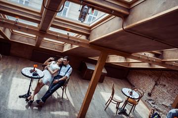Romantic couple in love bonding in cafe