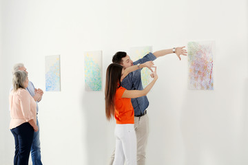 People looking at picture in art gallery