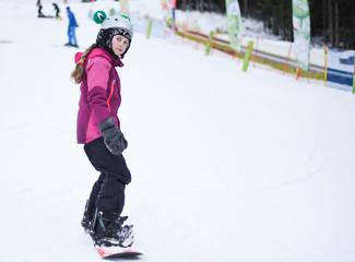 Little girl on snowboard