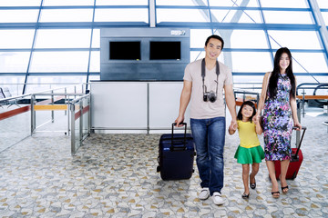 Asian family walking together on the airport
