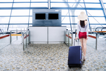 Female tourist walking in the airport terminal