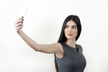 Businesswoman making selfie photo on smartphone