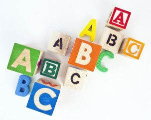 Looking down on a variety of colorful ABC blocks. No blocks d to z.