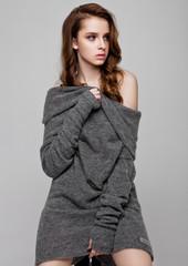 Young beautiful fashion model wearing knitwear jumper