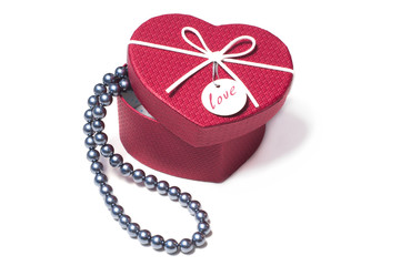 Black pearls in a gift Valentine's Day in box in the form of heart