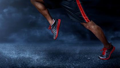 Man running on asphalt road