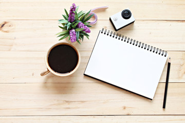 Business concept : Flat lay style of office workspace desk with blank notebook paper, cup of coffee, top view mock up