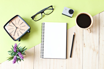 Business concept : Flat lay style of office workspace desk with blank notebook paper, cup of coffee and accessories, top view mock up