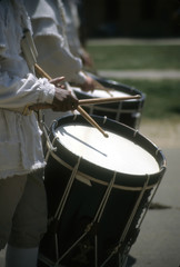 Drummers in white colonial uniforms