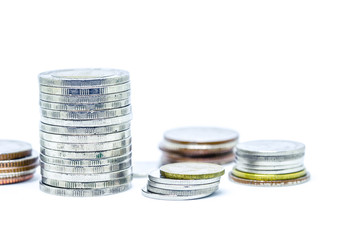 growing money and grow business. silver coin stack isolated on white
