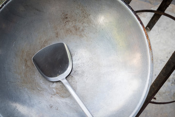 Old pan and ladle or scoop.