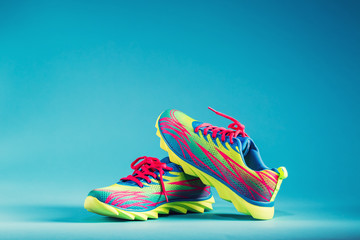 Colorful running sneakers on a blue background Wall mural