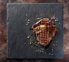 Beef steak Ribeye with rosemary, salt and pepper