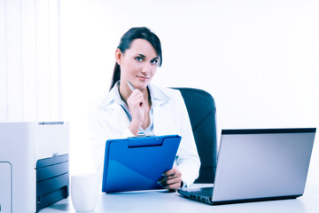 Young attractive business woman using laptop at the office