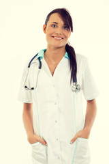 Female doctor with stethoscope standing at office and smiling at camera