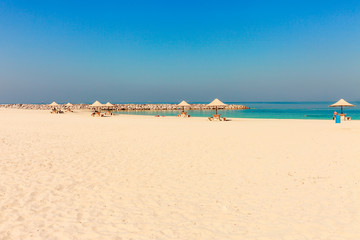Panoramic view on nice Al Mamzar beach in Dubai, UAE. United Arab Emirates famous tourist destination. Clear blue water Persian gulf, Indian Ocean
