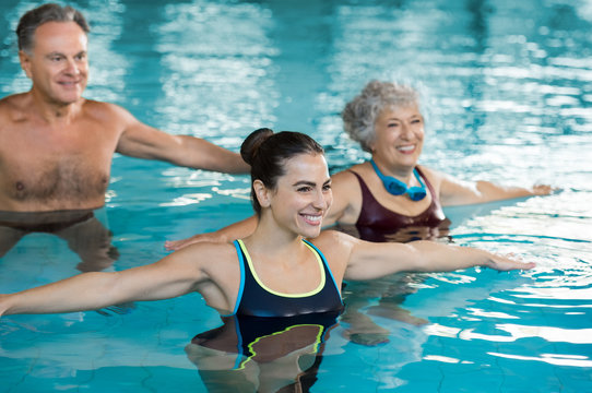 People exercising in pool