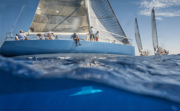 Blue sailing boat on the sea with keel under water