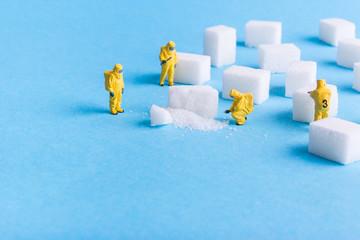 The team investigates the sugar cubes