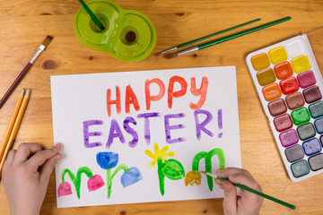 Kid draw greeting card for happy easter