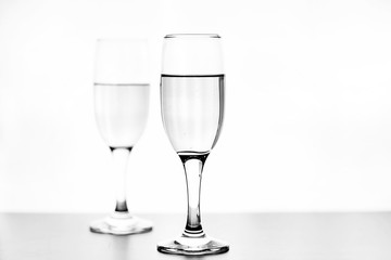 monochrome photo of champagne on white table on white background isolate