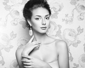 Black and white portrait of beautiful woman model with fresh makeup and romantic  hairstyle. Beauty girl with professional makeup. Jewelry. Fashion photo.