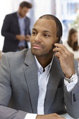 Portrait of handsome businessman on phone