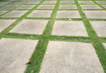 Block lane on lawn grass background.