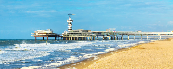 North Sea beach and Scheveningen Pier near Hague, Holland, Netherlands banner panoramic