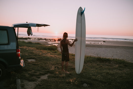 surfer, car and sunset