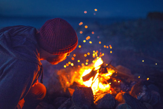 man and campfire