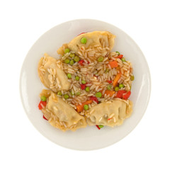 Top view of a vegetarian potstickers meal on a plate isolated on a white background.
