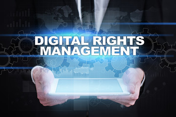 Businessman holding tablet PC with digital rights management concept.