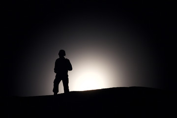 Silhouette Of A Soldier on a dark background