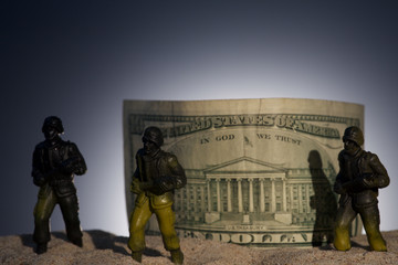 Silhouette of military soldiers on money background