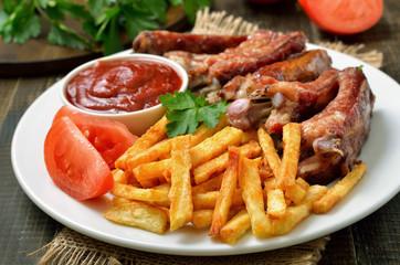 Potato fries and pork ribs
