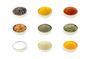 Colorful spices isolated on a pure white background.