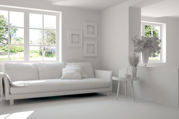 Grey room with sofa and green landscape in window. Scandinavian interior design