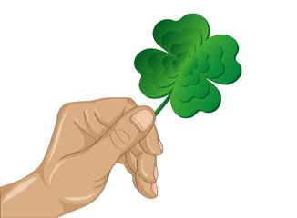 Hand holds ornate clover tree-leaf. Celebration concept Patrick