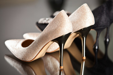 Background with beautiful shoes on shelves of shop.