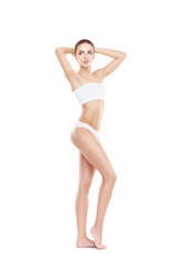 Fit, healthy and sporty woman in underwear isolated on white. Sport, fitness, diet, weight loss and healthcare concept.