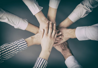 Hands stacked in a pile. A symbol of teamwork and trust.