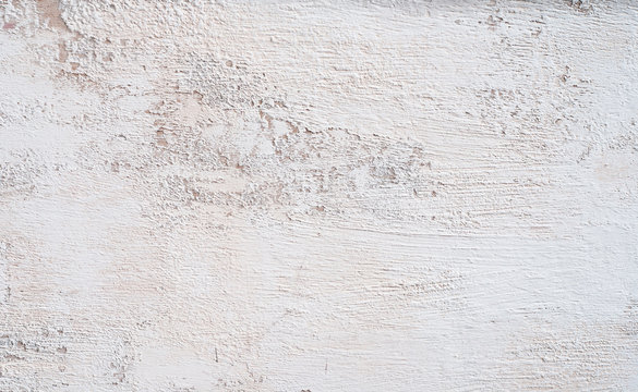 White whitewashed wall. Hight resolution texture. Grungy Shabby Uneven Painted Plaster In Whiten Facade. Web banner
