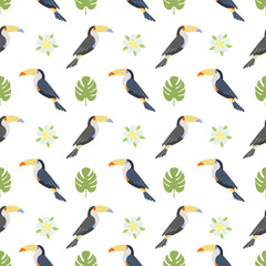 Colorful flying toucan birds with tropical flowers and palm leaves. Seamless pattern.